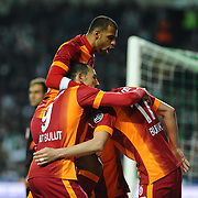 Galatasaray's Burak Yilmaz with team mate celebrate his goal during their Turkish Super League soccer derby match Torku Konyaspor between Galatasaray at the Konya Buyuksehir Belediyesi Torku Arena at Selcuklu in Konya Turkey on Saturday, 13 December 2014. Photo by Kurtulus YILMAZ/TURKPIX