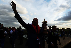 Team Europe captain Thomas Bjorn celebrates with the Ryder Cup on day three of the Ryder Cup at Le Golf National, Saint-Quentin-en-Yvelines, Paris.