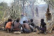 Africa, Tanzania, Lake Eyasi, Hadza tribe. A small tribe of hunter gatherers AKA Hadzabe Tribe. A group of men around a fire