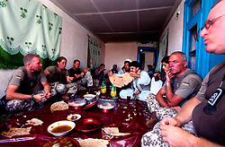 "YAFTAL PAYAN, 31 July 2005.German soldiers/ISAF having some food at Bitha Bala's guest house..They came here to meet the head of the village who, apparently, is not there..Ralph - on the left - says that their duty is to look at the life conditions of the villagers and to report it to the reconstruction team. .""The aim is to cooordinate the work of all NGOs operating in Afghanistan"" he adds."