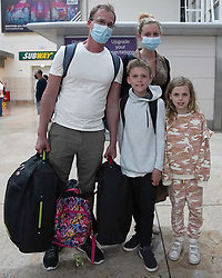 © Licensed to London News Pictures. 08/06/2021.Doncaster, UK. Nigel Cross, Johanna Cross, Thomas,9 and Ava 8, from Leeds arrived at 3am from Faro at Doncaster Sheffield airport ahead of the 4am implementation of quarantine rules. From 4am on Tuesday 8 June, Portugal will be removed from the Green list and added to the Amber list. Photo credit: Ioannis Alexopoulos/LNP <br /> ***Permission Granted