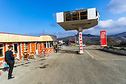 People are seen working and renovating a petrol station on the road from Goris to Stepanakert throughout the Lachin Corridor, in the self-proclaimed Nagorno-Karabakh Republic on Tuesday, Dec 22, 2020. Kamo Avetyan (not in picture) started renovating his petrol station facilities at the entry of Stepanakert, while trucks of Azerbaijan army (not in picture), accompanied by Russian peacekeeping troops drove along the Lachin corridor. Saddened seeing Azerbaijani army troops driving beside his business site, he said the war is not over. Russian peacekeepers control the five-kilometre-wide Lachin corridor, which provides communication between Nagorno-Karabakh and Armenia, the safe return of people to their places of residence, and the movement of civilian vehicles. The corridor is a mountain pass connecting Armenia and the enclave of Nagorno-Karabakh. The corridor is de jure in the Lachin District of Azerbaijan, but de facto in the Kashatagh Province of the self-proclaimed Republic of Artsakh. It contains the town of Lachin and the villages of Zabux and Sus. (Photo/ Vudi Xhymshiti)