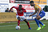 Mark Marshall of Charlton Athletic (7) takes on CJ Hamilton of Mansfield Town (22) during the The FA Cup match between Mansfield Town and Charlton Athletic at the One Call Stadium, Mansfield, England on 11 November 2018.