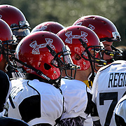 Players huddle up during the practice session at the Walt Disney Wide World of Sports Complex in preparation for the Under Armour All-America high school football game on December 3, 2011 in Lake Buena Vista, Florida. (AP Photo/Alex Menendez)