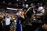 Kristaps Porzingis #46 of the New York Knicks signs autographs after defeating the San Antonio Spurs after an NBA Summer League game in Las Vegas, Nevada on July 11, 2015. (Cooper Neill for The New York Times)