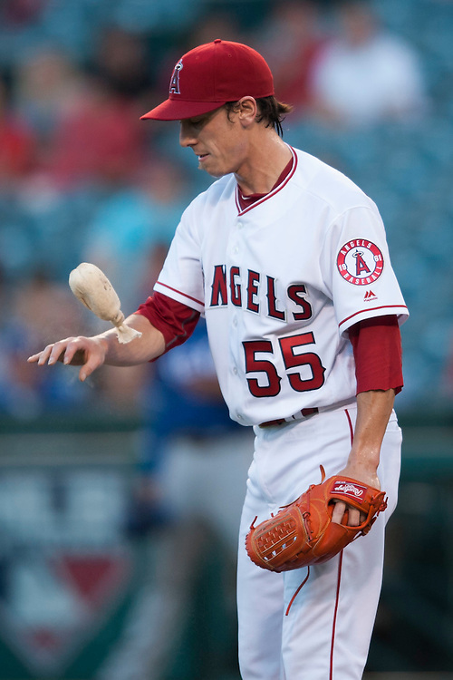 The Angels' Tim Lincecum gets some rosin while pitching against the Texas Rangers at Angel Stadium on Tuesday.<br /> <br /> ///ADDITIONAL INFO:   <br /> <br /> angels.0720.kjs  ---  Photo by KEVIN SULLIVAN / Orange County Register  -- 7/19/16<br /> <br /> The Los Angeles Angels take on the Texas Rangers at Angel Stadium.