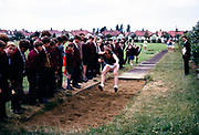 Boy competing in long jump event at secondary school sports day, Ilford County High school, Essex,  England in 1965