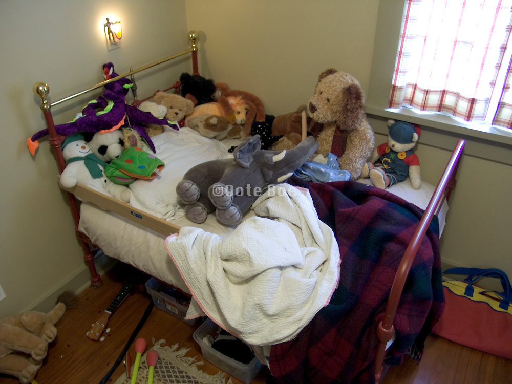 child?s bedroom with many toys
