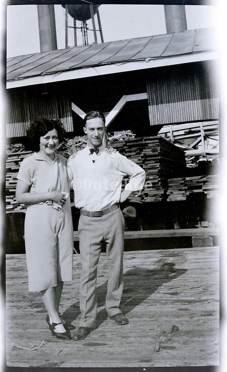 couple at wood cutting mill Missouri USA 1920s