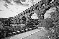 Black and white view of Pont du Gard (Roman Aqueduct), the second highest standing Roman structure, Vers-Pont-du-Gard, France.
