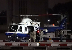 "EXCLUSIVE: **PREMIUM RATES APPLY** Mexican drug lord Joaquín ""El Chapo"" Guzman is transported from downtown Manhattan via NYPD chopper, final destination: Supermax Prison near Florence, Colorado. The 62 year-old Sinaloa cartel boss is carted away at 3:20am in shackles en route to La Guardia airport. He has been sentenced to life plus 30 years. **NO NEW YORK DAILY NEWS, NO NEW YORK TIMES, NO NEWSDAY**. 19 Jul 2019 Pictured: El Chapo. Photo credit: Christopher Sadowski / MEGA TheMegaAgency.com +1 888 505 6342"