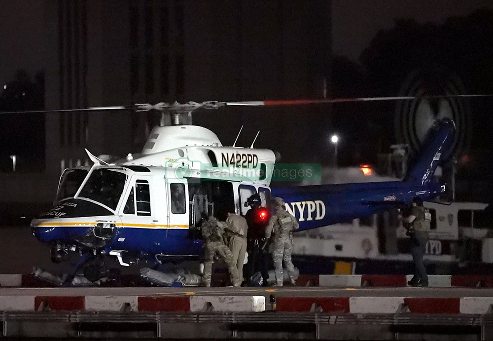 """EXCLUSIVE: **PREMIUM RATES APPLY** Mexican drug lord Joaquín """"ElChapo"""" Guzman is transported from downtown Manhattan via NYPD chopper, final destination: Supermax Prison near Florence, Colorado. The 62 year-old Sinaloa cartel boss is carted away at 3:20am in shackles en route to La Guardia airport. He has been sentenced to life plus 30 years. **NO NEW YORK DAILY NEWS, NO NEW YORK TIMES, NO NEWSDAY**. 19 Jul 2019 Pictured: El Chapo. Photo credit: Christopher Sadowski / MEGA TheMegaAgency.com +1 888 505 6342"""
