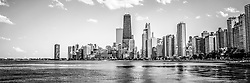 Chicago skyline panorama photo in black and white with the Hancock building and other popular downtown Chicago city buildings. The John Hancock Center building is one of the world's tallest skyscrapers and is a famous fixture in the Chicago skyline. Panoramic photo ratio is 1:3.