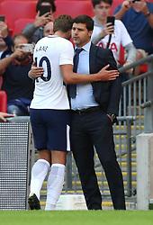 Tottenham Hotspur Mauricio Pochettino embraces Harry Kane on the touchline
