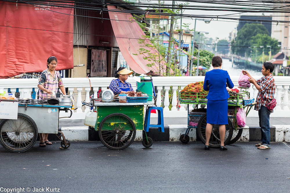 06 JUNE 2013 - BANGKOK, THAILAND:    Fruit vendors in front of Bobae Market on Krung Kasem Rd in Bangkok. Bobae Market is a 30 year old famous for fashion wholesale and is now very popular with exporters from around the world. Bobae Tower is next to the market and  advertises itself as having 1,300 stalls under one roof and claims to be the largest garment wholesale center in Thailand.       PHOTO BY JACK KURTZ