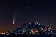 Comet C/2020 F3 (NEOWISE) and a meteor shine in the night sky over Mount Rainier in Washington state. Comet NEOWISE is a long-period comet and its current orbital path will take about 6,800 years to complete. Its nucleus is about 3 miles (5 kilometers) across and is covered with sooty, dark particles left over from its formation near the birth of our solar system 4.6 billion years ago. Mount Rainier, which has a summit of 14,411 feet (4,392 meters), is the highest mountain in Washington state and largest volcano in the Cascade Range.