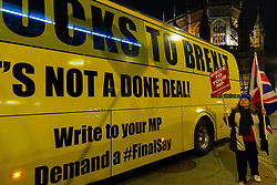 "A pro-Remain campaigner welcomes the arrival of a bus emblazoned with ""Bollox to Brexit"" at Steve Bray's ongoing pro-remain protest at Old Palace Yard outside Parliament. Westminster, London, December 20 2018."