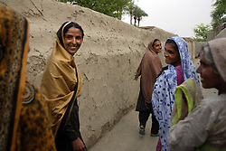 Mukhtar Mai, 33, laughs with relatives during a visit her to aunts house, Meerwala, Pakistan, April 28, 2005 Mai, went against the Pakistani tradition of committing suicide when she brought charges against the men who gang raped her nearly three years ago.