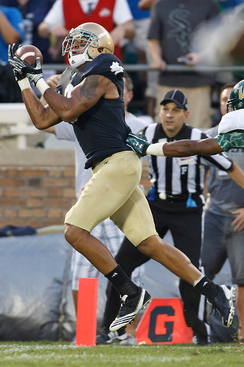 Notre Dame wide receiver Michael Floyd (#3) catches touchdown pass in third quarter action during NCAA football game between Notre Dame and South Florida.  The South Florida Bulls defeated the Notre Dame Fighting Irish 23-20 in game at Notre Dame Stadium in South Bend, Indiana.