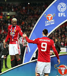 Zlatan Ibrahimovic of Manchester United hands the EFL trophy to Paul Pogba during the celebrations - Mandatory by-line: Matt McNulty/JMP - 26/02/2017 - FOOTBALL - Wembley Stadium - London, England - Manchester United v Southampton - EFL Cup Final