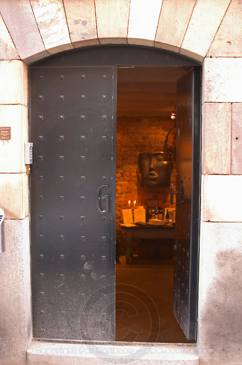 The iron cellar door with a wrought iron G leading in to the reception At the wine cellar storage company Grappe in Stockholm where private individual s can store and age wine bottles. Källaren Grappe Wine Storage Cellar, Stockholm, Sweden, Sverige, Europe
