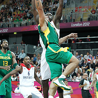 31 July 2012: Brazil Alex Garcia goes for the layup over Luol Deng during 67-62 Team Brazil victory over Team Great Britain, during the men's basketball preliminary, at the Basketball Arena, in London, Great Britain.