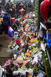 © Licensed to London News Pictures. 28/12/2016. London, UK. Tributes are left outside the London home of singer and musician George Michael, in Highgate, North London. Pop superstar George Michael died on Christmas day at his Oxfordshire home on the River Thames aged 53. Photo credit: Ben Cawthra/LNP