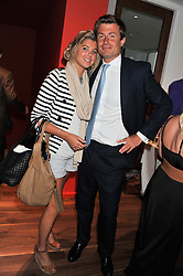 TESS SHEPHERD and ED BRADLEY at Inception Group's Hamptons Garden Party to celebrate their collaboration with Embassy Gardens 2016 held at the Ballymore Marketing Suite, Nine Elms Lane, London on 12th July 2012.
