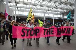 London, UK. 31st August, 2021. Environmental activists from Extinction Rebellion march through London Bridge station on the ninth day of their Impossible Rebellion protests. Extinction Rebellion are calling on the UK government to cease all new fossil fuel investment with immediate effect.