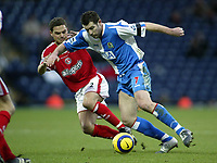 The FA Barclays Premiership<br />3 January 2005, Ewood Park, Blackburn<br />Blackburn Rovers v Charlton Athletic<br />Blackburn Rovers Brett Emerton is challenged by Charlton Athletic's Luke Young<br />Pic Jason Cairnduff/Back Page Images