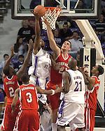 Nebraska center Aleks Maric (upper right) blocks Kansas State's David Hoskins (upper left) shot in the first half.  The Huskers defeated K-State 57-42 at Bramlage Coliseum in Manhattan, Kansas, January 11, 2006.