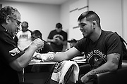 Efrain Escudero has his hands wrapped before his fight against Drew Dober during UFC 188 at the Mexico City Arena in Mexico City, Mexico on June 13, 2015. (Cooper Neill)