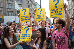 London, UK. 17th April 2019. Climate change activists from Extinction Rebellion, who continue to occupy Oxford Circus as part of International Rebellion activities, listen and dance to music in a carnival-like atmosphere from a sound system on the Ship of Truth.