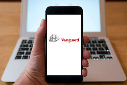 Vanguard fund management company logoon smart phone screen.
