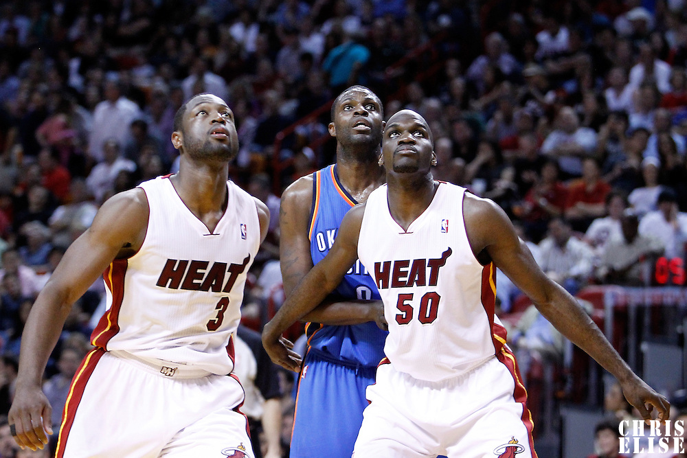 16 March 2011: Oklahoma City Thunder power forward Serge Ibaka (9) vies for the rebound with Miami Heat center Joel Anthony (50) and Miami Heat shooting guard Dwyane Wade (3) during the Oklahoma City Thunder 96-85 victory over the Miami Heat at the AmericanAirlines Arena, Miami, Florida, USA.