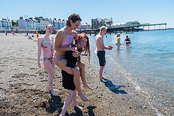 © Licensed to London News Pictures. 29/06/2018. Aberystwyth, UK. A group of young woman enjoy the sea as people flock to the seaside in Aberystwyth as the scorchingly hot  and very dry weather continues to dominate the UK Photo credit: Keith Morris/LNP