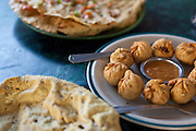 Fried momo and papadum are commonly eatne in Nepal.