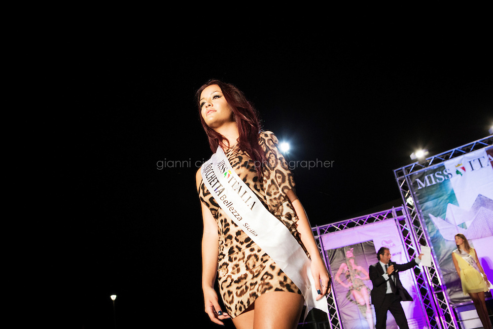 VILLAFRANCA TIRRENA, ITALY - 28 August 2013: Stefania Vincenzi, the 18 years old daughter of the missing and presumed dead Costa Concordia cruise ship passenger Mariagrazia Trecarichi, sits here as a juror for the Sicilian regional selections of Miss Italy, in Villafanca Tirrena, Italy, on August 28th 2013. Stefania Vincenzi was selected as one of the Sicilian representatives who will participate at the final selections of Miss Italy in Salso Maggiore in September 2013. The idea of participating at the beauty pageant came after Mariagrazia Trecarichi met a friend who organizes the local castings who told her Stefania suited the contest.