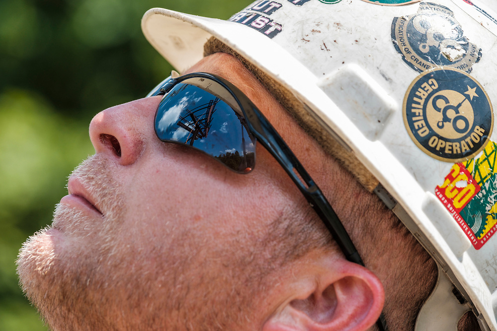 Operations Manager Robert Farthing, with the structure reflected in his glasses, watches as technicians from Lamar Advertising install a digital billboard structure along Wards Road in Lynchburg, VA Wednesday, August 29, 2018. U.S. companies are investing in re-training efforts to fill a slew of open positions as a tight labor market and changing job requirements makes it hard to find qualified staffers.<br /> CREDIT: Justin Ide for The Wall Street Journal<br /> RETRAIN