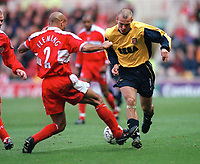 Fredrik Ljungberg (Arsenal) slips the ball between (nutmegs) Curtis Fleming (Middlesbrough). Middlesbrough 0:1 Arsenal. F.A.Carling Premiership, 4/11/2000. Credit: Colorsport / Stuart MacFarlane