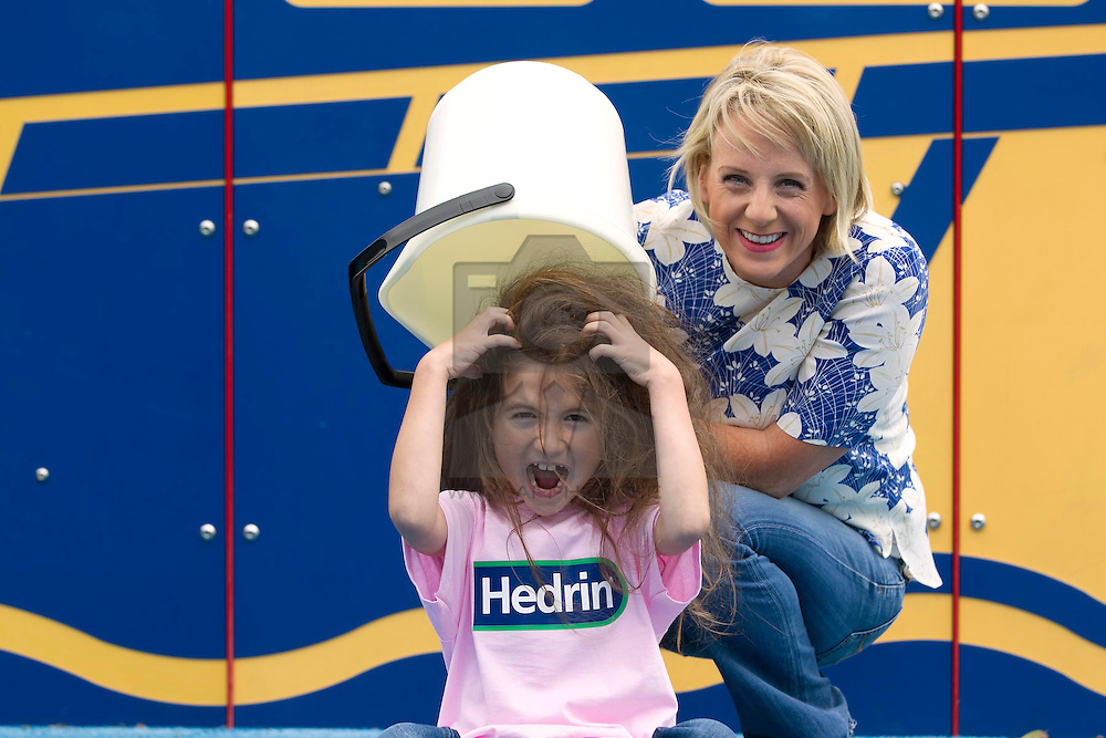 Repro Free: 09/09/2013 TV3's Sybil Mulcahy is pictured with Allegra Lupu (6) from Clonee lifting the lid on head lice at the launch of two new products to the Hedrin range that treats head lice, Treat & Go and Hedrin Protect & Go to help deal with the back to school outbreaks, a common occurrence with young children being in such close proximity. For the truth behind on all knits and all the facts on how to treat head lice visit www.onceaweektakeapeek.ie Picture Andres Poveda