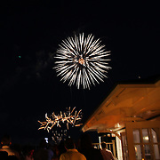 Patrons at Galley Beach beachside restaurant, watch a nearby firework display. Nantucket, Nantucket Island, Massachusetts, USA. Photo Tim Clayton