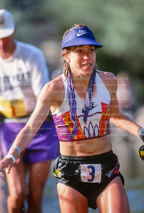 AUBURN, CA - JUNE 25:  Ann Trason #3 of the United States cross the American River at Rucky Chucky at mile 78 of the Western States 100 ultramarathon trail race on June 25, 1994 in the Sierra Nevada mountains between Squaw Valley and Auburn, California.  Trason finished second overall in the race.  (Photo by David Madison/Getty Images)