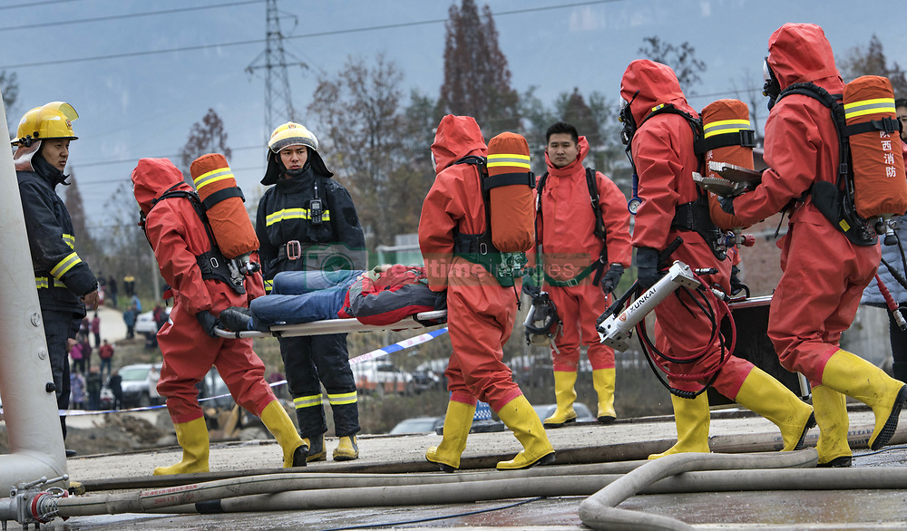 November 20, 2018 - Hanzhong City, China - Rescuers take part in an emergency exercise simulating hazardous chemicals transportation accident at Ningqiang County of Hanzhong City, northwest China's Shaanxi Province. The exercise was conducted to help enhance capabilities to respond to the emergency. (Credit Image: © Tao Ming/Xinhua via ZUMA Wire)