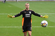 Huddersfield Town goalkeeper Jonas Lossl looks on. Premier league match, Swansea city v Huddersfield Town at the Liberty Stadium in Swansea, South Wales on Saturday 14th October 2017.<br /> pic by  Andrew Orchard, Andrew Orchard sports photography.
