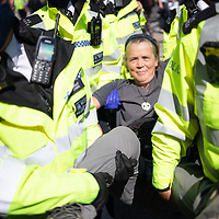 A protestor is arrested and carried away by Police in a large civil disobedience protest outside Parliament in London by Extinction Rebellion, urging government to take urgent action on climate change.