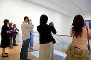 tourist photographing Henri Matisse painting La Dance at the Museum of Modern Art