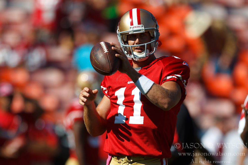 Oct 30, 2011; San Francisco, CA, USA; San Francisco 49ers quarterback Alex Smith (11) warms up before the game against the Cleveland Browns at Candlestick Park. Mandatory Credit: Jason O. Watson-US PRESSWIRE