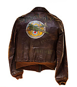 """John H. Hammond, a waist gunner on the """"Spirit of '76"""", wore this type A2 flight jacket. The 568th squadron patch is attached to the front of the jacket, and the name """"Spirit of '76"""" is painted on the back above a B-17 over the 8th air force logo. Each bomb painted on the back signifies a successful mission that Hammond flew."""