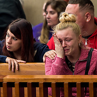 An unidentified family member comforts Jade Collier - sister of Seth Collier - on Friday, Nov. 17, 2017  during sentencing of Peter Rauch, who pleaded  guilty of leaving the scene of a motor vehicle crash and vehicular manslaughter.  Rauch hit Seth Collier on March 21, 2017; he died two days later. <br />N.Scott Trimble